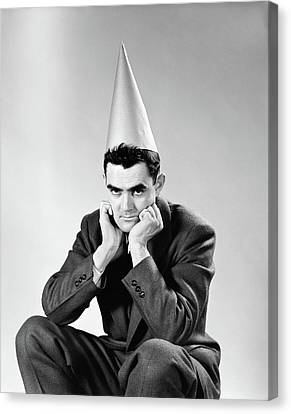 Punishment Canvas Print - 1950s Disguntled Man Wearing Dunce Cap by Vintage Images