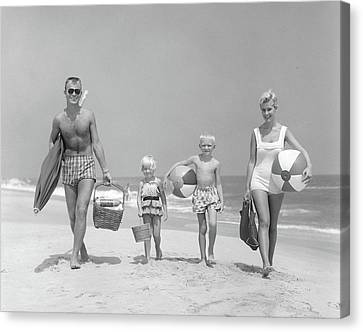 Beach Pails Canvas Print - 1950s Family Of Four Walking Towards by Vintage Images