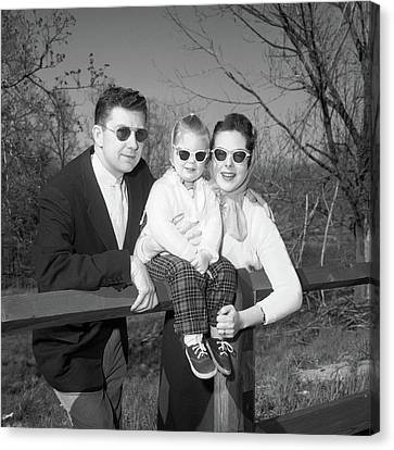Husband And Wife Canvas Print - 1950s Family Portrait With Sunglasses by Vintage Images