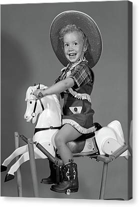 Tomboy Canvas Print - 1950s Girl Dressed As Cowgirl Riding by Vintage Images