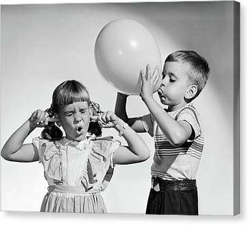 Anticipation Canvas Print - 1950s Little Boy Blowing Up Big Balloon by Vintage Images