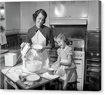 Love Making Canvas Print - 1950s Mother & Daughter Baking A Cake by Vintage Images