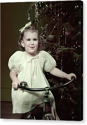 Tricycle Canvas Print - 1950s Smiling Girl Riding Tricycle by Vintage Images