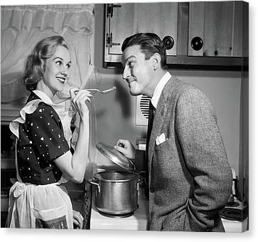 Love Making Canvas Print - 1950s Smiling Housewife At Stove Giving by Vintage Images