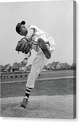 Pitching Canvas Print - 1950s Teen In Baseball Uniform Winding by Vintage Images
