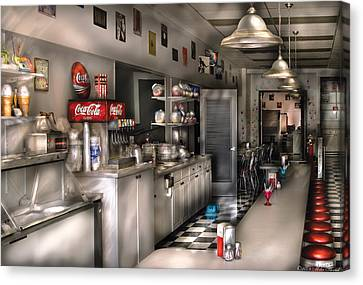 1950's - The Soda Fountain Canvas Print by Mike Savad