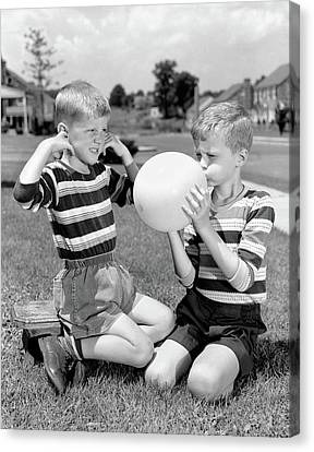 Blows Air Canvas Print - 1950s Two Young Boys One Blowing by Vintage Images