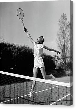 Racquet Canvas Print - 1950s Woman Jumping To Hit Tennis Ball by Vintage Images