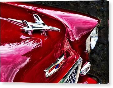 1955 Chevy Bel Air Hood Ornament Canvas Print by Peggy Collins
