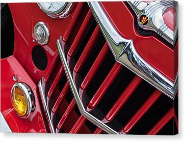 1957 Willys Jeep 6-226 Wagon Grille Emblem Canvas Print by Jill Reger