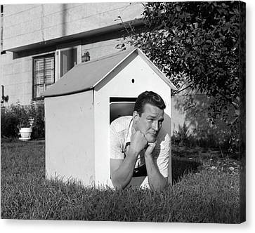 Punishment Canvas Print - 1960s Man In Doghouse In Backyard by Vintage Images