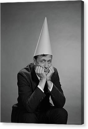 Punishment Canvas Print - 1960s Man Wearing Dunce Cap by Vintage Images