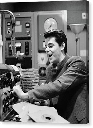 Disc Canvas Print - 1960s Radio Disc Jockey In Studio by Vintage Images
