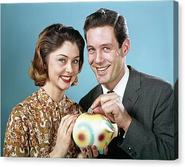 Piggy Bank Canvas Print - 1960s Smiling Couple Looking At Camera by Vintage Images