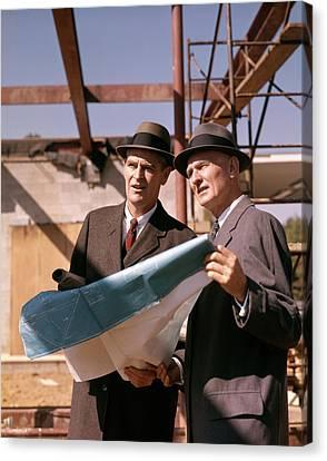 Bonding Canvas Print - 1960s Two Men Reviewing Blueprints by Vintage Images