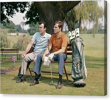Bonding Canvas Print - 1960s Two Men Sitting Under Tree by Vintage Images