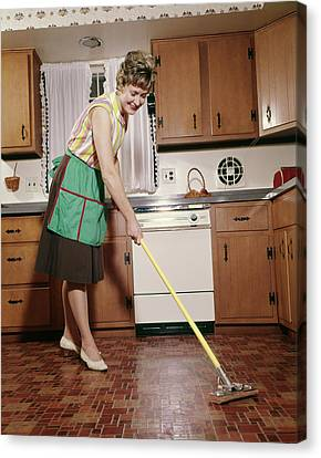 Linoleum Canvas Print - 1960s Woman In Apron Cleaning Kitchen by Vintage Images