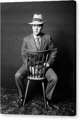 Backward Canvas Print - 1970s Man Seated Backwards On Chair by Vintage Images