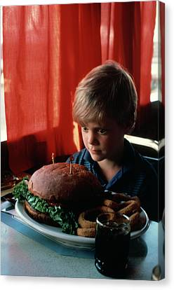 Confronting Canvas Print - 1980s Boy Confronted Overwhelmed by Vintage Images