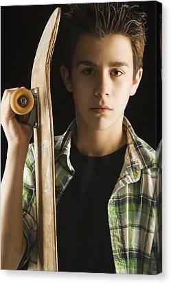 A Boy With A Skateboard Canvas Print by Darren Greenwood