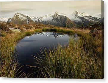 An Alpine Lake Canvas Print by Lorenzo Tonello