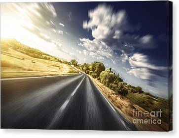 Asphalt Road In Field Against Moody Canvas Print by Evgeny Kuklev