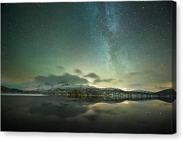Aurora Borealis And Milky Way Canvas Print by Tommy Eliassen
