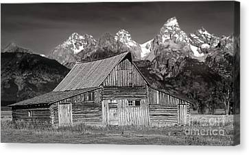Canvas Print featuring the photograph Barn And Tetons by Jerry Fornarotto
