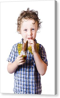 Boy Eating Easter Egg Canvas Print by Jorgo Photography - Wall Art Gallery