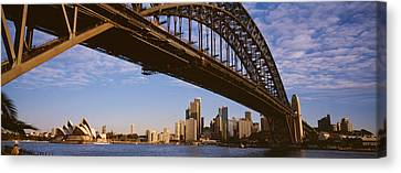 Bridge Across The Bay With Skyscrapers Canvas Print by Panoramic Images