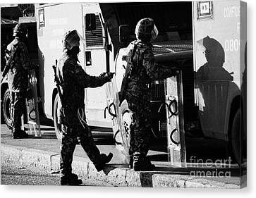 British Army Soldiers In Riot Gear On Crumlin Road At Ardoyne Shops Belfast 12th July Canvas Print by Joe Fox
