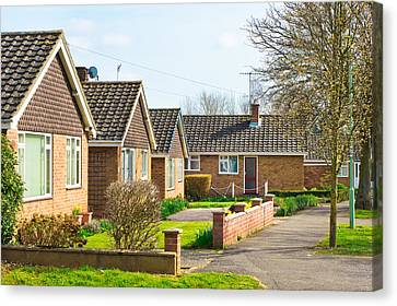 Bungalows Canvas Print by Tom Gowanlock