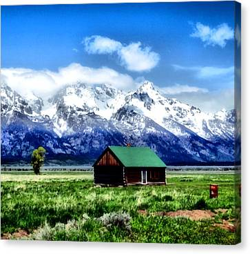 Cabin In The Mountains Canvas Print by Dan Sproul