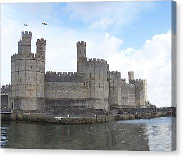 Canvas Print featuring the photograph Caernarfon Castle by Christopher Rowlands