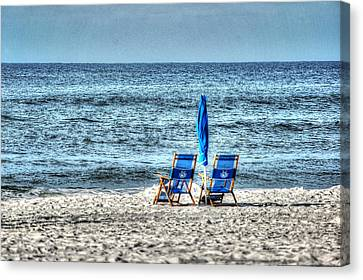 2 Chairs And Umbrella Canvas Print by Michael Thomas