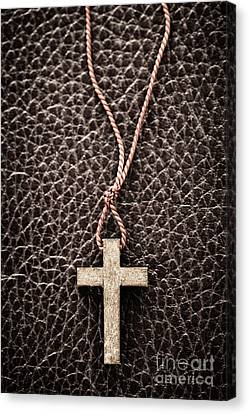 Christian Cross On Bible Canvas Print by Elena Elisseeva