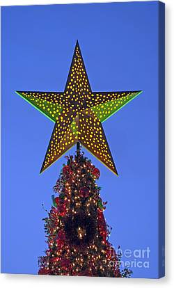 Christmas Star During Dusk Time Canvas Print by George Atsametakis