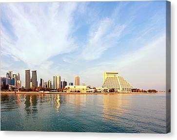 Doha Bay At Sunset Canvas Print by Paul Cowan