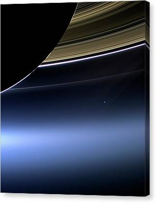 Earth And Moon From Saturn Canvas Print by Nasa