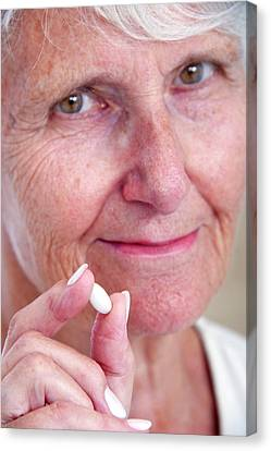 Elderly Woman With Medication Canvas Print by Lea Paterson
