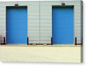 Factory Doors Canvas Print by Tom Gowanlock