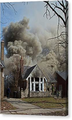 Firefighters Attending A House Fire Canvas Print by Jim West