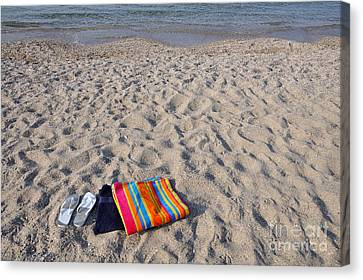 Flip Flops And Towels On Beach Canvas Print by George Atsametakis