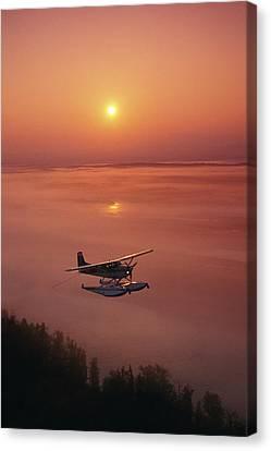 Matanuska Canvas Print - Floatplane Flying  Sunset Matanuska by Jeff Schultz