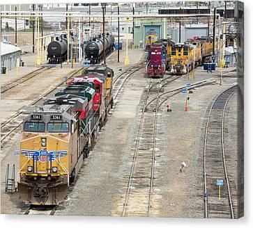 Rail Siding Canvas Print - Freight Trains At A Rail Yard by Jim West