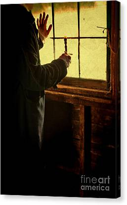 Gentleman In 18th Century Clothing With A Candle Canvas Print by Jill Battaglia