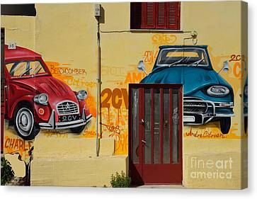 Graffiti On A Wall Canvas Print by George Atsametakis