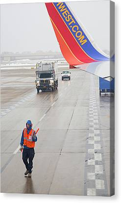 Air Travel Canvas Print - Ground Crew Worker At Chicago Airport by Jim West