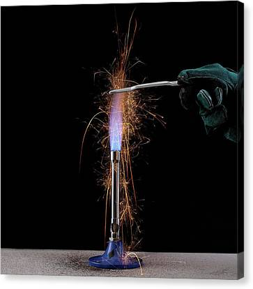 Iron Filings In A Gas Flame Canvas Print by Science Photo Library