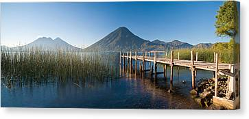 Jetty In A Lake With A Mountain Range Canvas Print